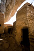 Cool safe dark Dogon houses under an overhanging cliff