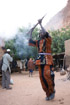 A man noisily celebrating the opening of a pharmacy in his village near Bandiagara, Mali
